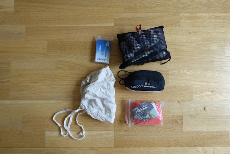 Travel gear packed into lower zip pocket in main compartment of Minaal Carry-on