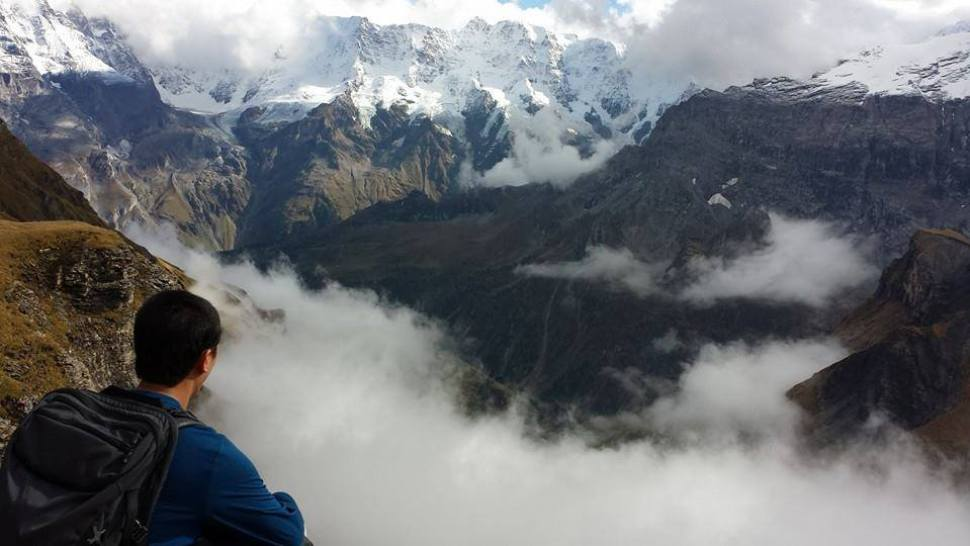 Daryl Ferreras climbing Schilthorn Bernese Alps with his Minaal Carry-on hiking backpack