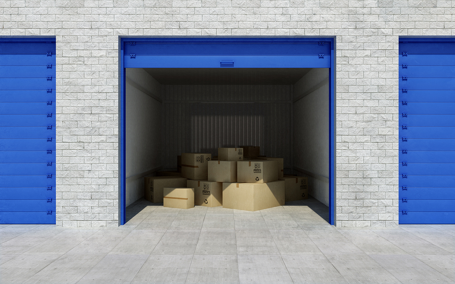 open storage unit with too many boxes, owners need to maximize space