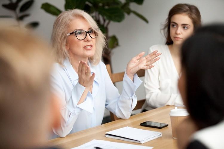 woman in white shirt conducting an effective meeting