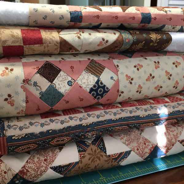 ct-jo-stack-of-quilts