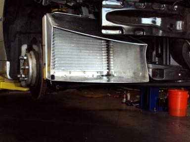 The Oil Cooler Shroud directs cool air directly into the cooler's core, enhancing cooling capacity.