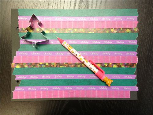 Stick a Washi tape pattern on the cardboard and trace the shape of the cuttie cutter onto it