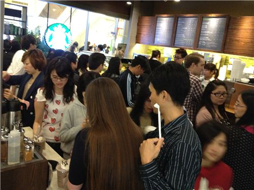 Out team pushed to one side of the new and highly packed Starbucks coffee shop