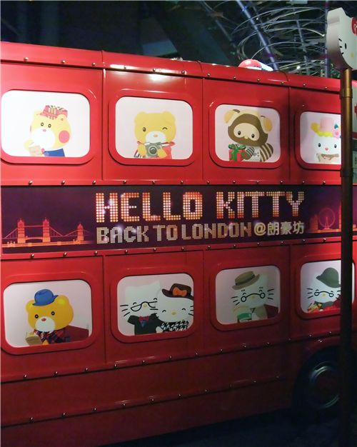 Hello Kitty and friends on a red Hello Kitty bus