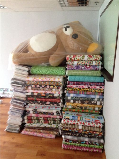 Big Rilakkuma relaxed well protected on a pile of fabrics while everybody else was working