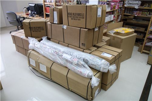 lots of big cartons, the long boxes are for the laminate fabrics
