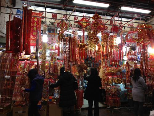 a stationery shop with CNY decoration in Tsim Sha Tsui at nighttime