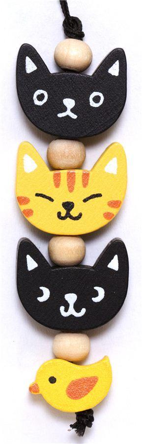 little cat heads wooden phone strap