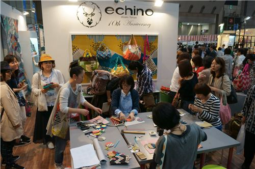 Women making handbag decoration from wonderful Echino fabrics.