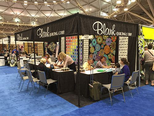 Busy at the Blank Quilting both with some beautiful flower patterns in the background.