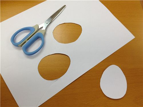 Start by cutting out egg shapes from paper