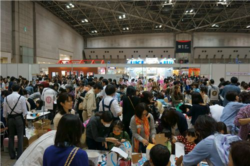 Large exhibition halls with thousands of people who try many of the presented products