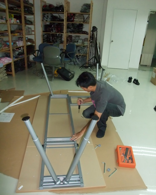 Alan assembling the table