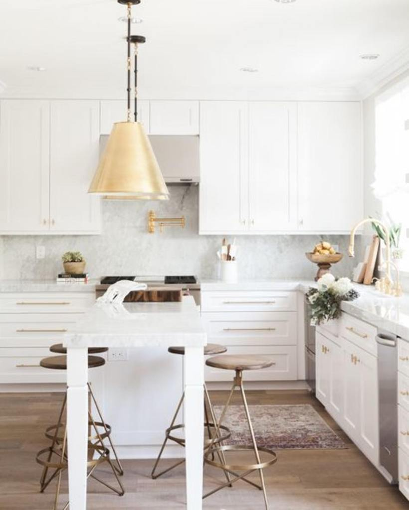 How gorgeous is this kitchen?! We love the gold whitehellip