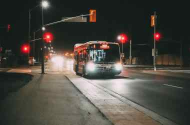bus on road at night