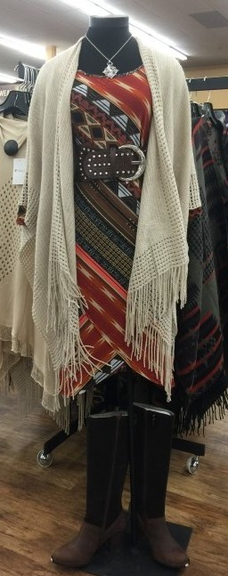 Fringed cream poncho