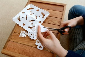 Escape boredom by making paper snowflakes