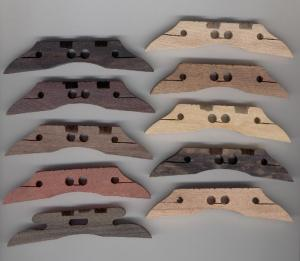 Ten mandolin bridges.