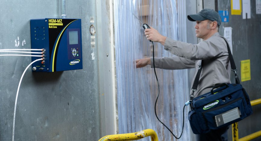 Refrigeration contractor inspecting a supermarket's walk-in freezer for refrigerant leaks.
