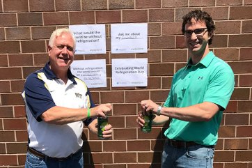 Zachary Ziegler and Bill Carlson celebrate World Refrigeration Day at Neutronics' offices in Exton, PA.