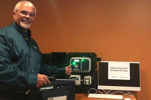 Glenn Smith poses with Bacharach's PGM-IR and MGS-400 products.