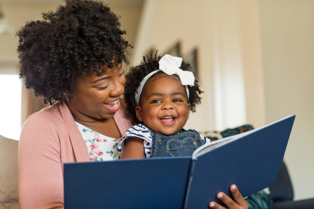 A happy mother and baby reading