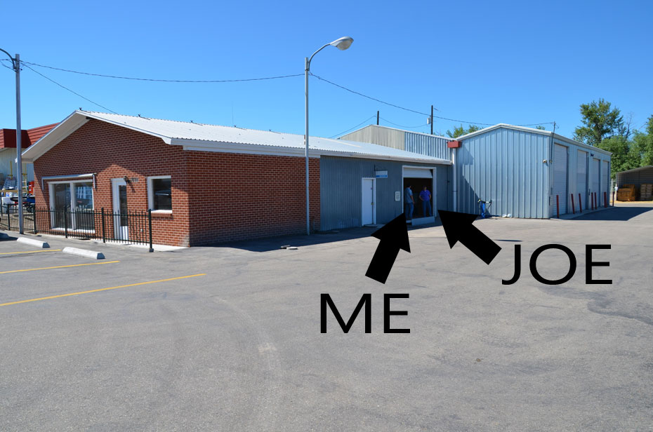 Exterior of online sales warehouse, featuring Joe and Armando