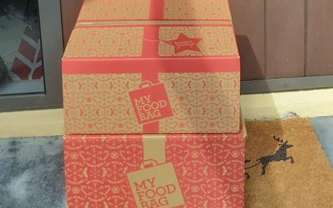 My Food Bag Christmas boxes outside a foodie's door. Made from sustainable sources.