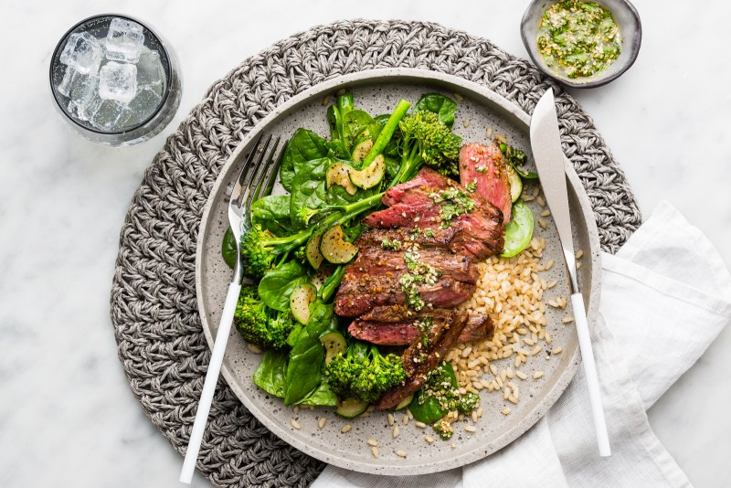 marinated beef with greens and brown rice