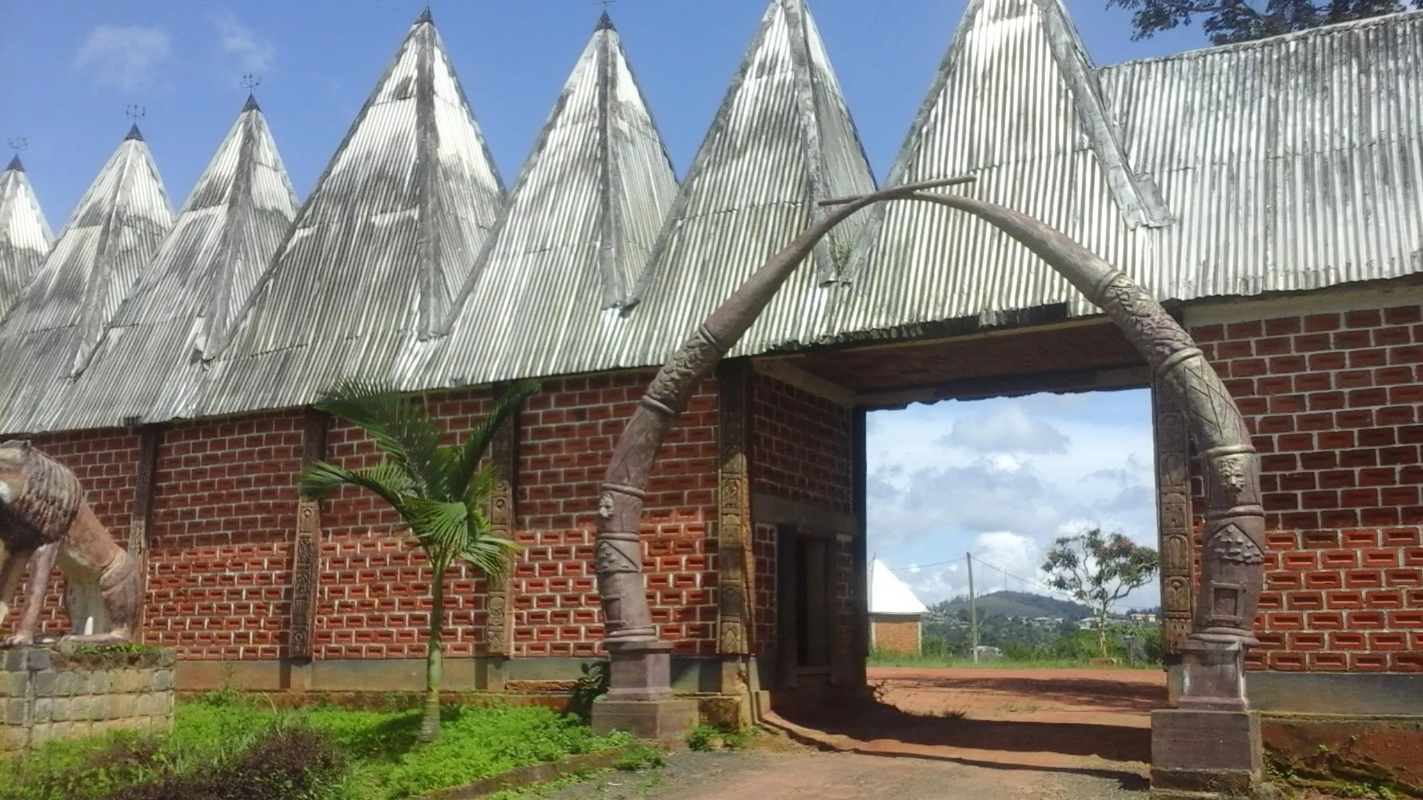 Photo of the entrance to the Bazou Chieftaincy, home of the Bamileke people in Bandounga, Cameroon.