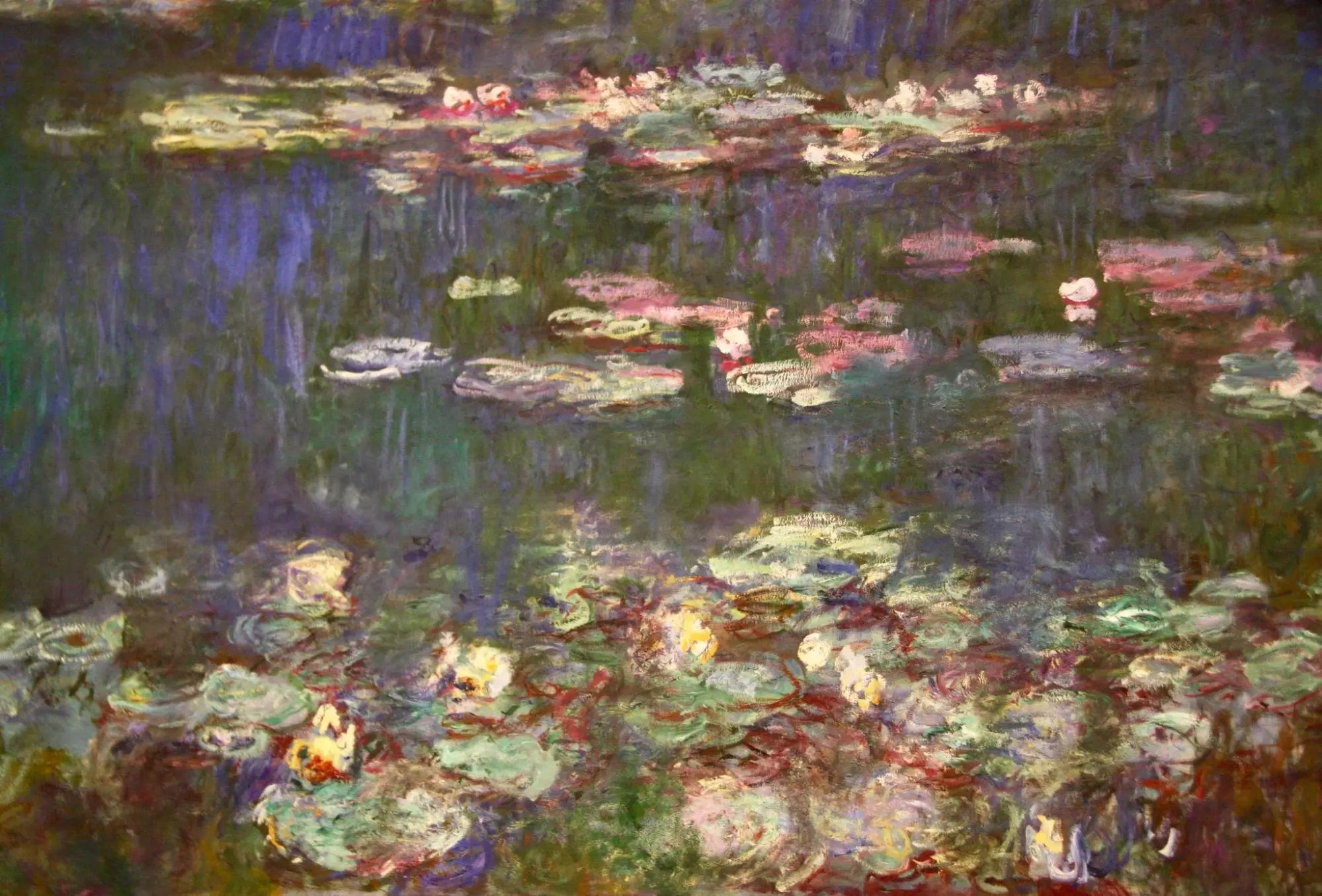 A closeup of one of Monet's water lily paintings in the Musee de l'Orangerie in Paris