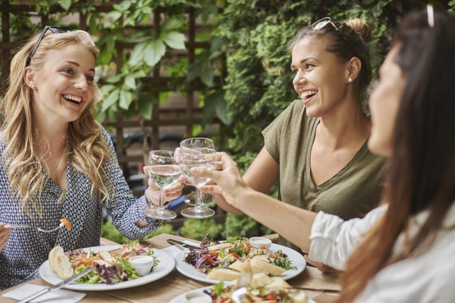 Women eating a healthy salad meal at a restaurant