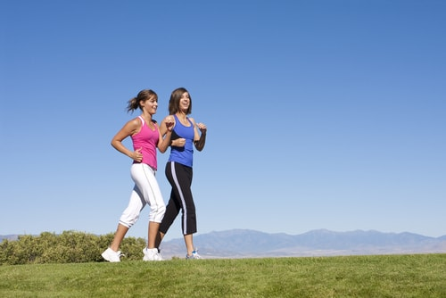 Women power walking for fitness in an open area