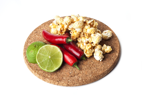 Jalapeno popcorn with limes and chili peppers