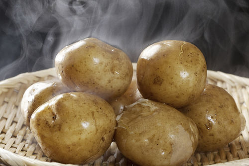 Freshly steamed potatoes with steam rising off
