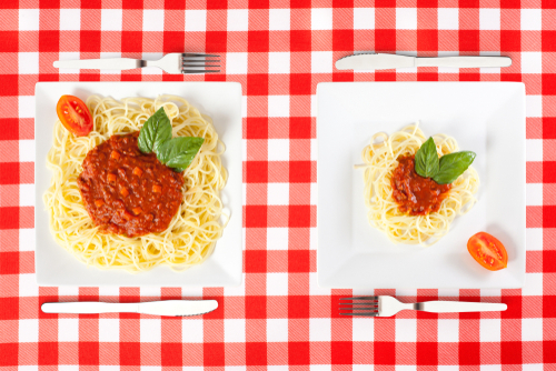 Large and small portion servings of pasta comparison
