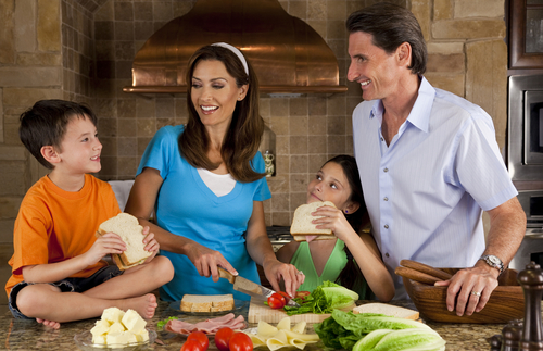 Family making healthy sandwiches together