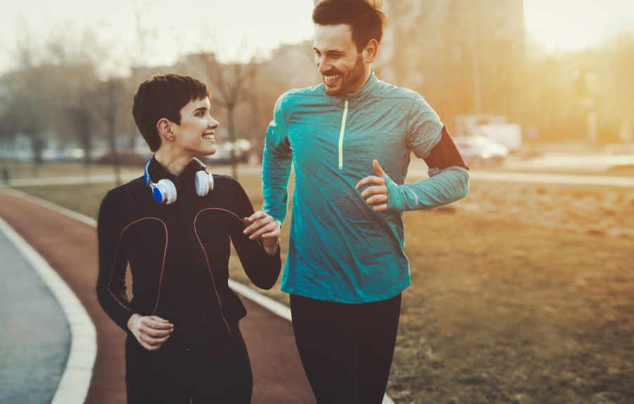 Man and woman walking for fitness on a jogging track