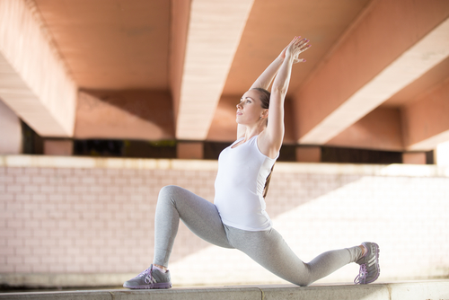 Woman doing stretch or yoga pose for flexibility
