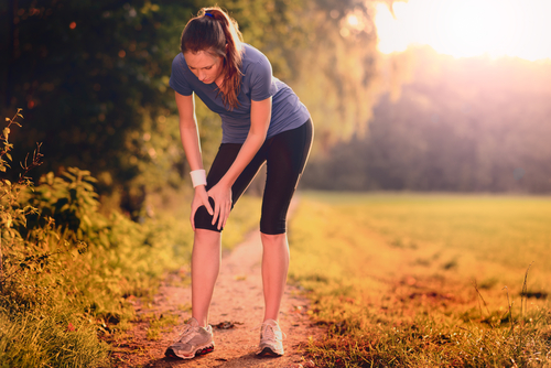 Woman Walking with injured knee