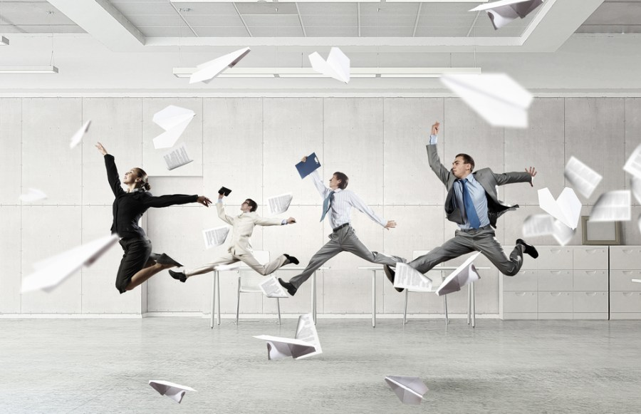 Businesspeople dancing - active office concept