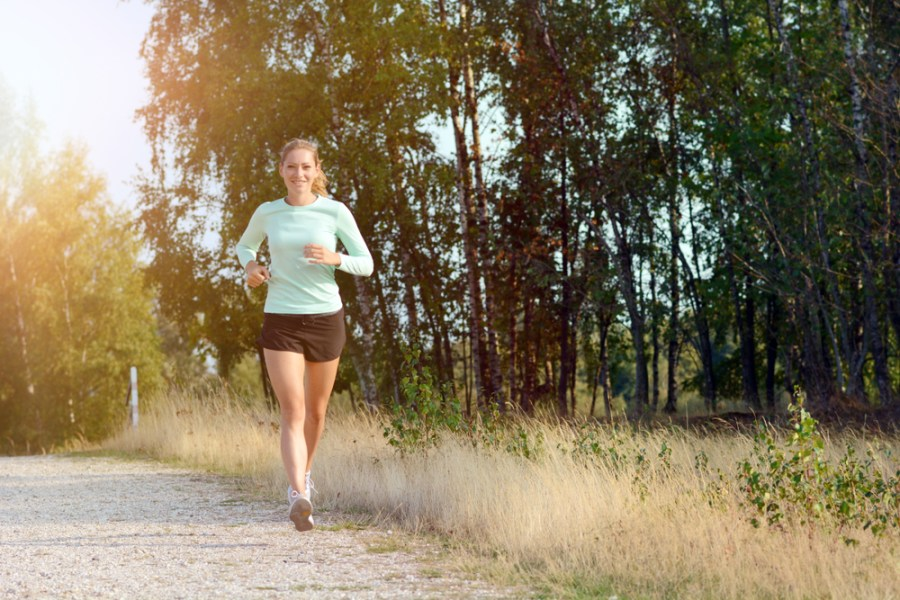 Woman jogging for fitness on a country road