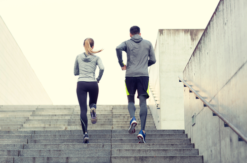 Active joggers running stairs