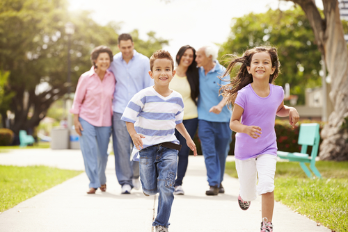 Family walking together in neighborhood