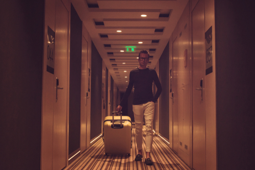 Walking in hotel hallway