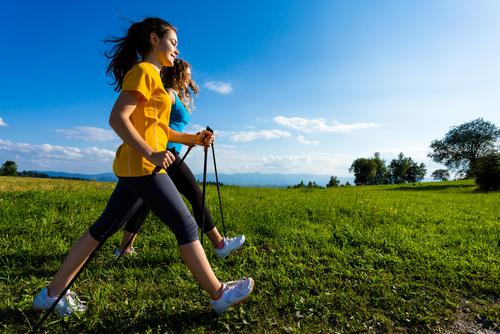 brisk walking with poles in a field