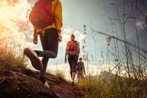 Men and women hiking in hills
