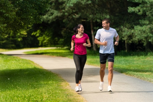 couple doing jogging or brisk walking