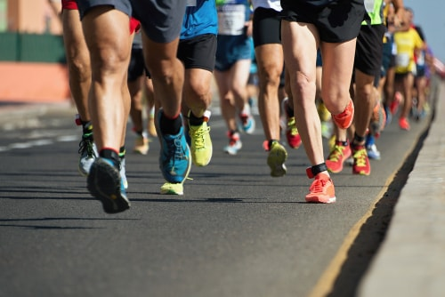 Marathon runners with a focus on their feet